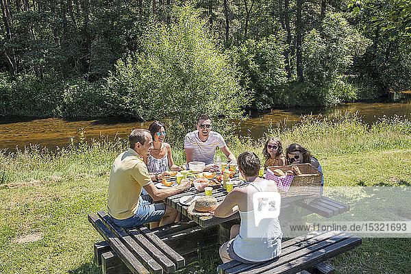 Auvergne - Rhone-Alpes - Haute-Loire - Saint-Julien-d'Ance - Family picnic on the bank of the Ance river.