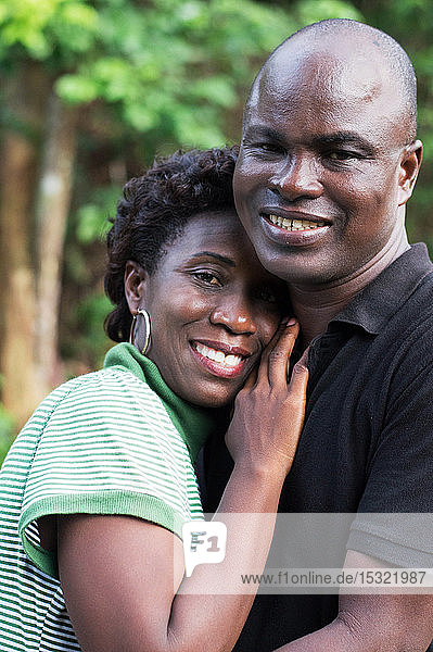 happy young couple embracing in countryside.