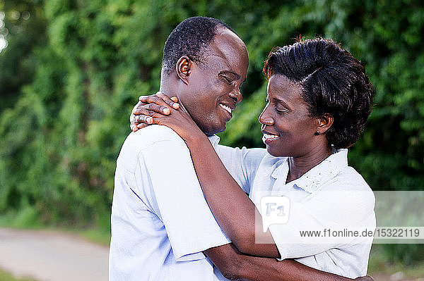 happy young couple embracing face to face in campaign