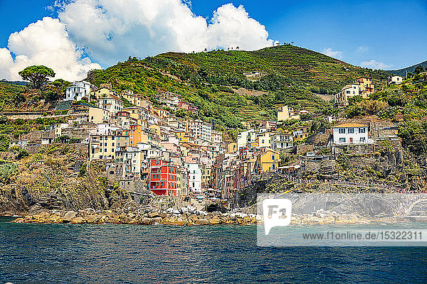 Riomaggiore  Cinque Terre  Liguria  Italy - 09 August 2018 - view of the colorful houses and the harbor from the sea