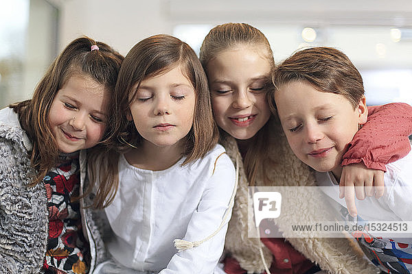 Four children closing eyes