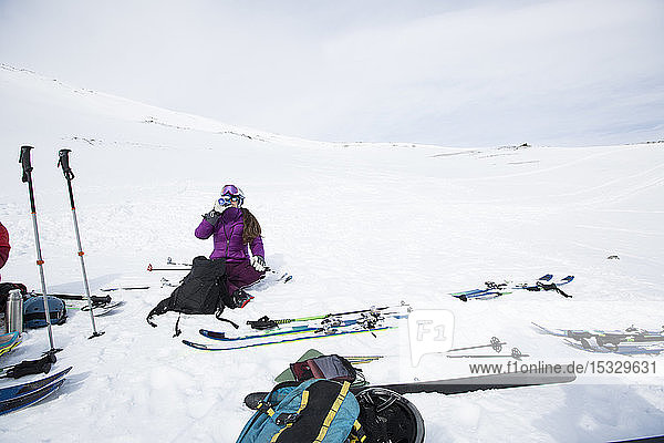 Woman resting from cross country skiing