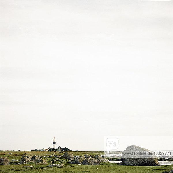 View of distant Lange Jan lighthouse on Oland  Sweden View of distant Lange Jan lighthouse on Oland, Sweden