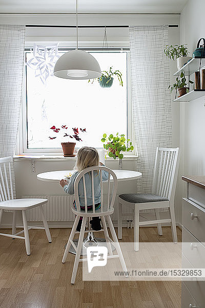 Girl sitting at a table