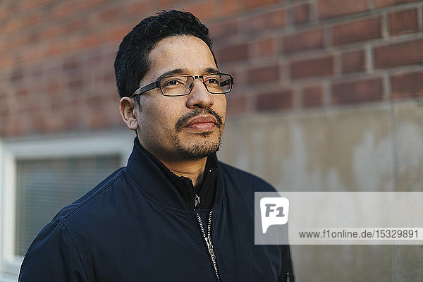 Portrait of mid adult man wearing glasses