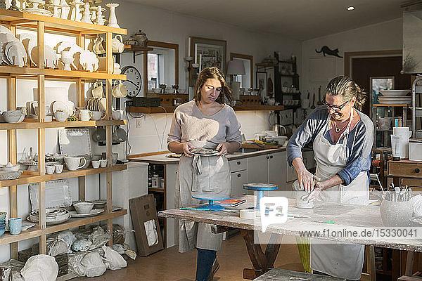 Women in pottery workshop