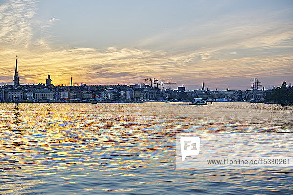Skyline of old town by sea at sunset in Stockholm  Sweden Skyline of old town by sea at sunset in Stockholm, Sweden