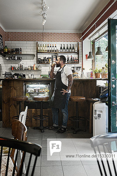 Mid adult man working in cafe