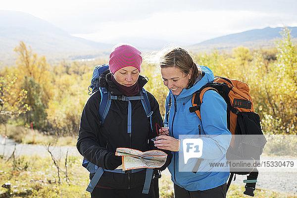 Women reading map