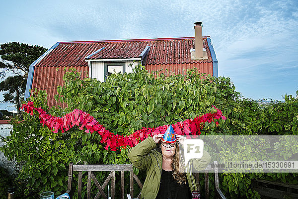 Mid adult woman having party in backyard