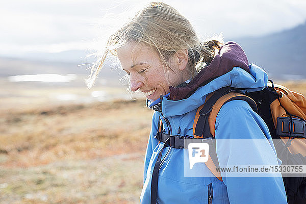 Woman smiling during hike