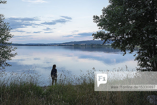 Woman standing by Lake Landsjon  Sweden