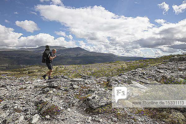Man hiking in Rondane National Park  Norway