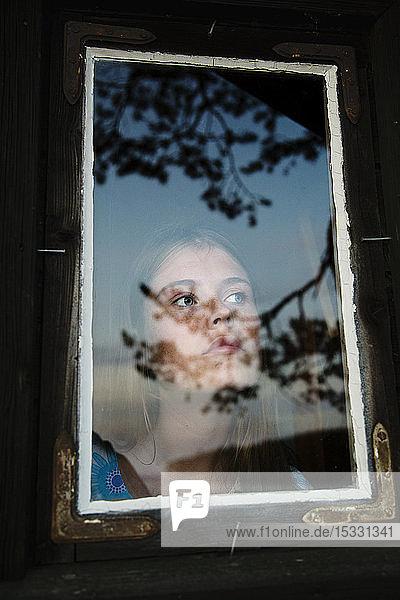 Portrait of young woman in summerhouse in Dalarna  Sweden Portrait of young woman in summerhouse in Dalarna, Sweden