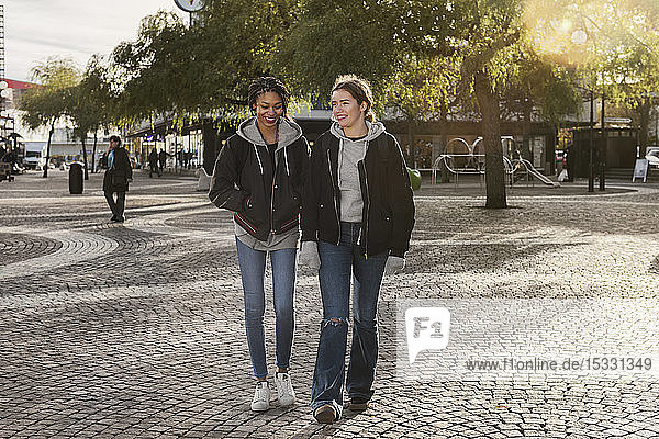 Teenage girls walking on cobblestone
