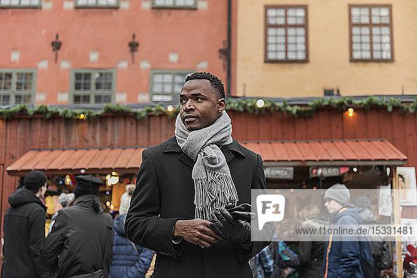 Young man at winter market Young man at winter market