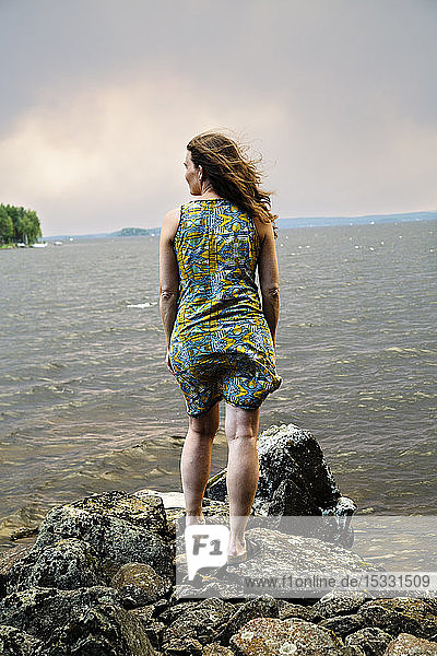 View of woman standing and looking at view