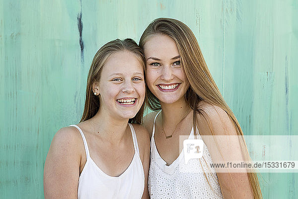 Portrait of sisters smiling Portrait of sisters smiling