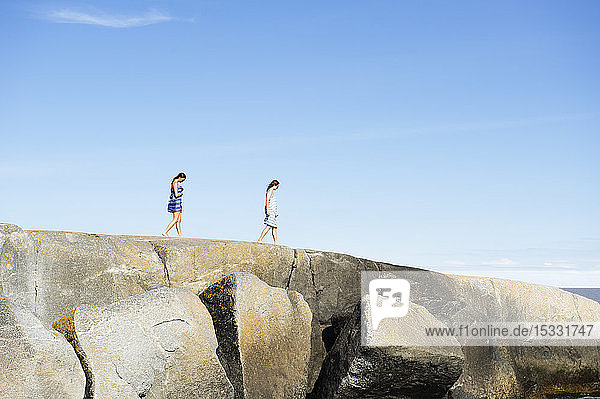 Women walking on rocks