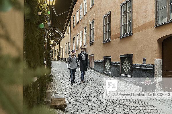 Couple holding hands on street in Stockholm  Sweden