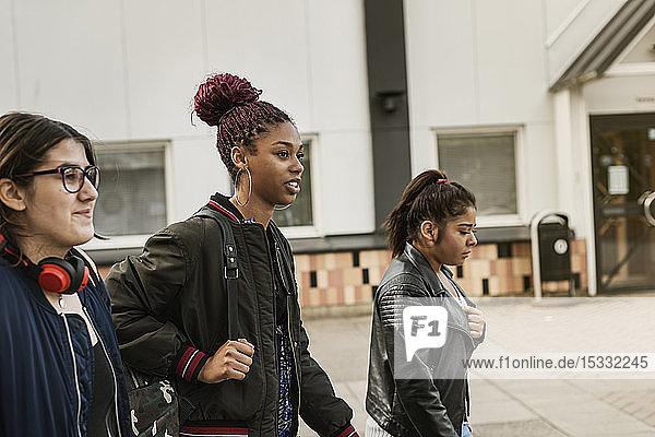 Teenage girls on footpath