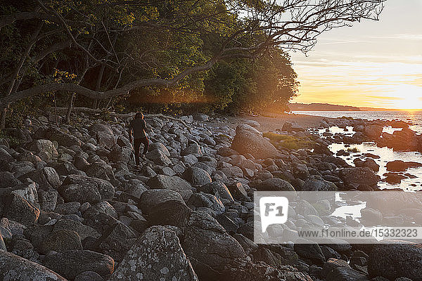 Man on rocks at sunset