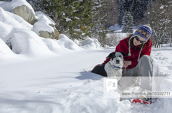 Italy  Lombardy  Retiche Alps  Camonica Valley  snowshoeing on the trail to the ancient alpine church of San Clemente
