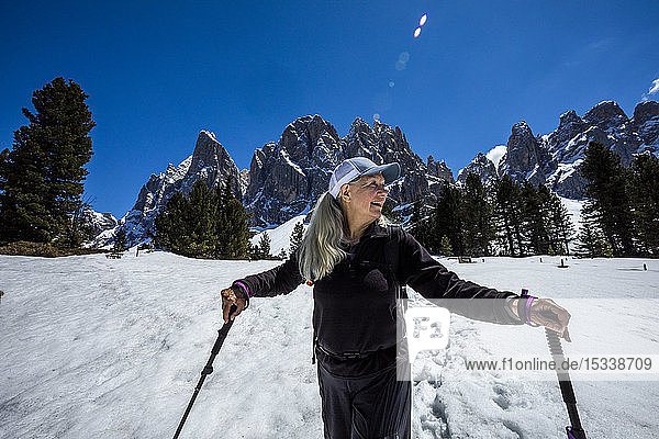 Woman hiking on Munkel Trail in Dolomites  Italy