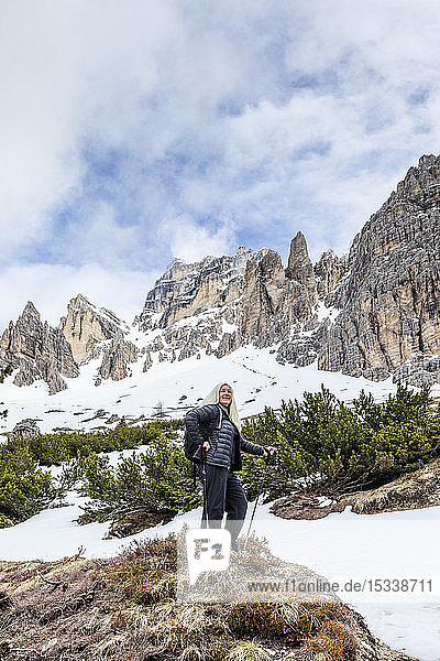 Woman hiking on Giau Pass in Dolomites  Italy