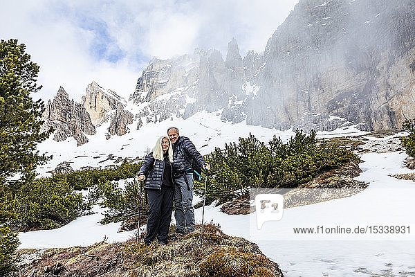 Couple hiking on Giau Pass in Dolomites,  Italy
