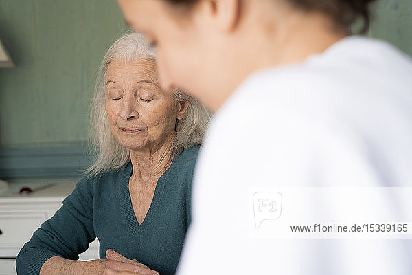 Patient sitting with doctor