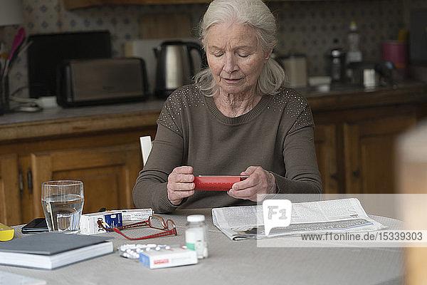 Woman looking at pill box