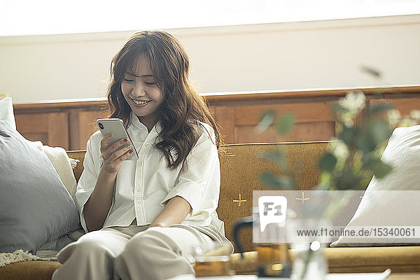 Young Japanese woman on the sofa
