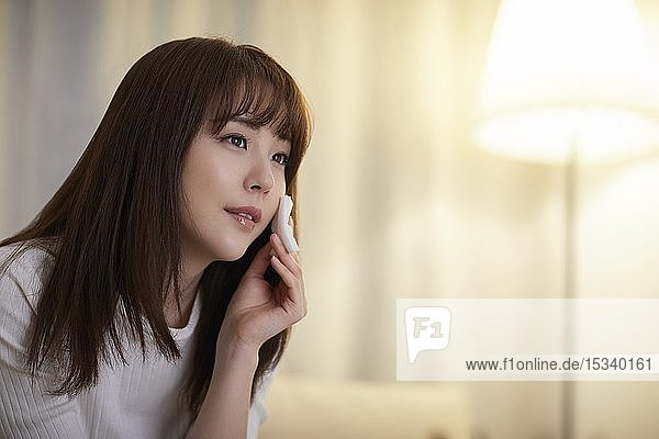 Young Japanese woman in the living room