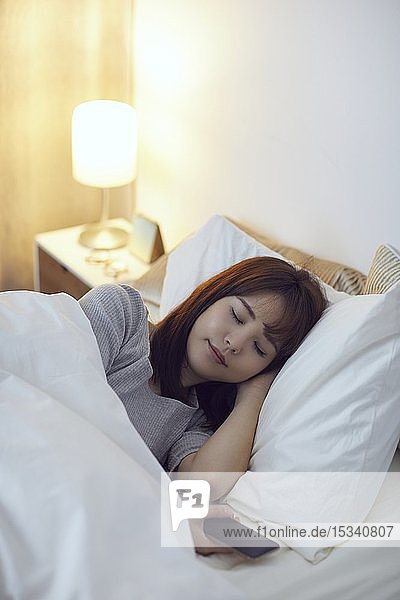 Young Japanese woman in bed