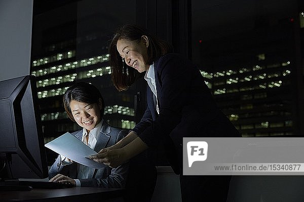 Japanese business people working late at night