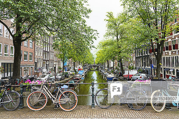 Bicycles on a bridge  Bloemgracht Canal  Amsterdam  North Holland  The Netherlands  Europe