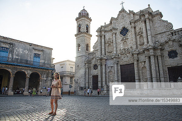 Tourist in Cathedral Square (Plaza de la Catedral) in Old Havana  UNESCO World Heritage Site  Havana  Cuba  West Indies  Caribbean  Central America