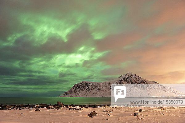 The Northern Lights (Aurora borealis) with mountain range in winter  Reine  Lofoten Islands  Nordland  Arctic  Norway  Europe