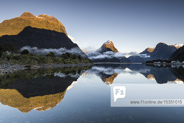 Low cloud lying below Mitre Peak at Milford Sound  Fiordland National Park  UNESCO World Heritage Site  South Island  New Zealand  Pacific