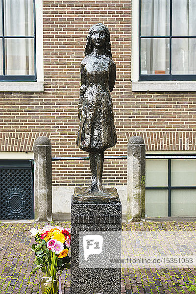 Statue of Anne Frank outside Westerkerk Church  Amsterdam  North Holland  The Netherlands  Europe