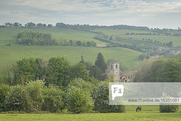 Rural church in beautiful Cotswolds countryside on a hazy spring morning  Naunton  Gloucestershire  England  United Kingdom  Europe