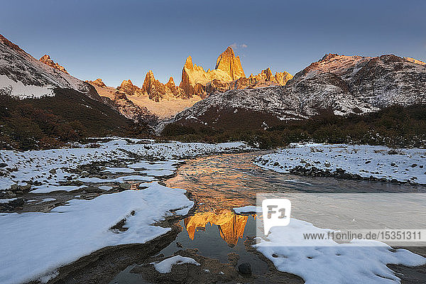 Mountain range with Cerro Fitz Roy at sunrise reflected in river  Los Glaciares National Park  UNESCO World Heritage Site  El Chalten  Patagonia  Argentina  South America