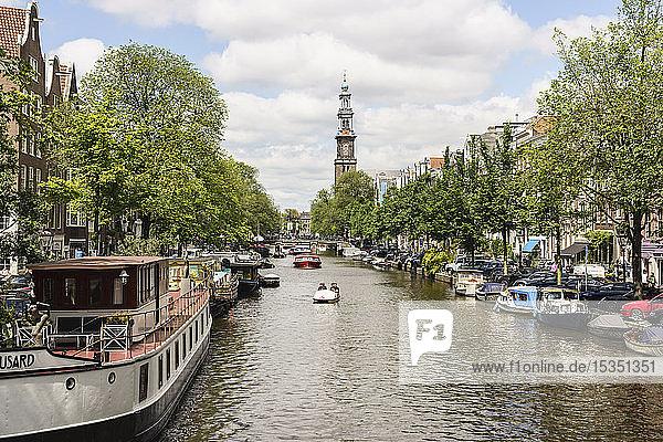 Prinsengracht canal looking towards Westerkerk church  Amsterdam  North Holland  The Netherlands  Europe