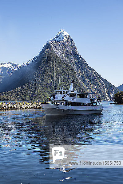 Milford Adventurer Cruise ship at Milford Sound with snow capped Mitre Peak  Fiordland National Park  UNESCO World Heritage Site  South Island  New Zealand  Pacific