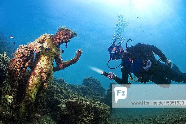 Diver with statue of Greek God Dionysus. Baia (Baiae)  Campi Flegrei (Phlegraean Fields)  Campania  Italy  Mediterranean  Europe