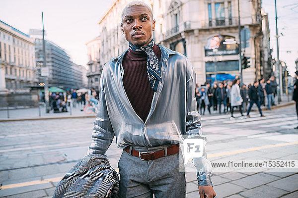 Stylish man walking in street  Milan  Italy