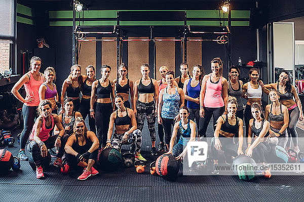Large group of women training in gym,  portrait