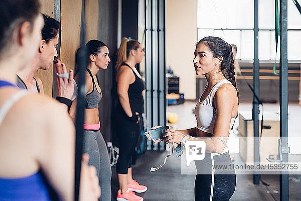 Women training in gym  preparing