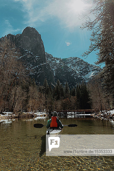 Man kayaking in lake  Yosemite Village  California  United States